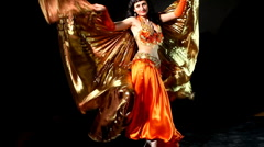 Arabic dancer with gold wing - edit cut - stock footage