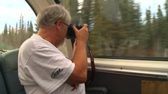Man photographing forest in train different angle Stock Footage
