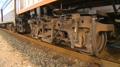 Railroad, pan locomotive trucks and undercarriage Stock Footage