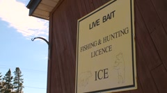 quaint quirky sign -  live bait fishing license - stock footage
