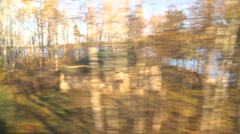 Rail travel, passing fishing lodge and lake Stock Footage