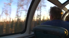 Railroad, riding the dome car, early morning sun pan to lake Stock Footage