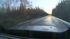 Railroad, riding the dome car, early morning sun front of car Stock Footage