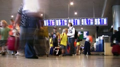 People stand near the display board at the airport Domodedovo, Moscow. Stock Footage
