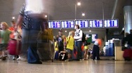 Stock Video Footage of People stand near the display board at the airport Domodedovo, Moscow.