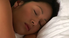 Young woman waking up from sleep Stock Footage