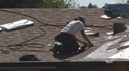 Stock Video Footage of Roofing contractor carefully aligns shingles