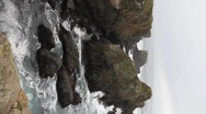Calif cliff and waves Stock Footage