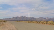 A slow pan to an abandoned diner with a sign reading eat in the Mojave desert. Stock Footage