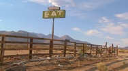 Pan shot across and abandoned diner with a sign saying eat. Stock Footage