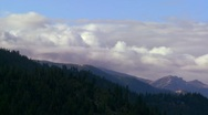 Stock Video Footage of Clouds roll over the Sierra Nevada mountains near Lake Tahoe.