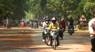 Stock Video Footage of Tuk-tuks and motorcycles on a paved road