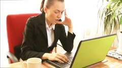Tired businesswoman in front of the laptop - stock footage