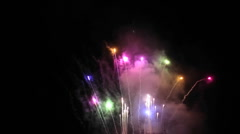 A fireworks show at night. - stock footage