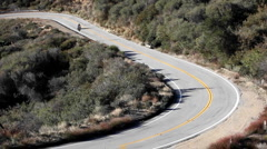 Motorcycle and cars on winding mountain road - stock footage