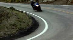 Motorcycle on a winding mountain road - stock footage