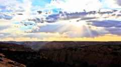 Time lapse of clouds passing over a desert canyon Stock Footage