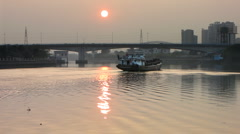 River barge sunset in China Stock Footage