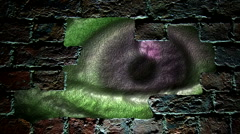 Strange looking eye peering through a hole in brick wall Stock Footage