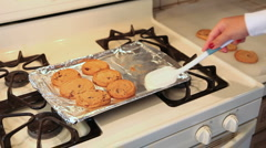 Cookies coming off a pan Stock Footage