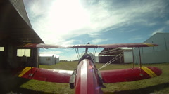 Aircraft, tail mounted POV camera - biplane idling on ground Stock Footage