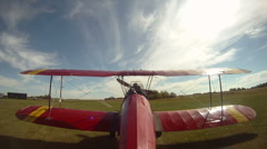 Aircraft, biplane taxi on grass strip, tail mounted camera. Wide angle, full vie Stock Footage
