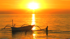 Bali Sunset Boat Lovina Beach Boys Play Swim Tropical Paradise Golden Exotic  Stock Footage