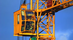 Extreme close-up of working tower crane cabin at sunset Stock Footage