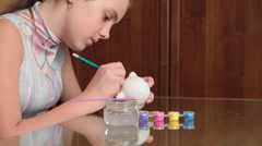 Girl plans colouring borders. Stock Footage