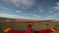 aircraft, tail mounted POV camera - biplane fly landing on grass strip - stock footage