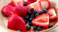 Stock Video Footage of Strawberries and Blueberries in a Bowl