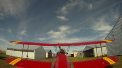 Aircraft, tail mounted POV camera - biplane taxi to hangar and shutdown Stock Footage