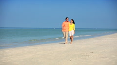 Young Couple Walking the Beach Stock Footage