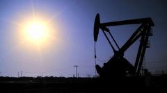 Silhouette of oil pumpjacks in operation. Stock Footage