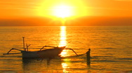 Stock Video Footage of Bali Sunset Boat Lovina Beach Boys Play Swim Tropical Paradise Golden Exotic