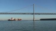 Ship passing by bay bridge San Francisco Stock Footage