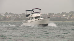 boat powers through big sea swell - stock footage
