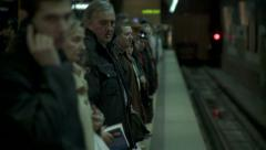 Waiting the train at the subway. - stock footage