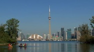 Canoes in front of Skyline Toronto, Canada Stock Footage