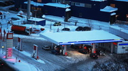 Cars refuel at petrol station in winter Stock Footage