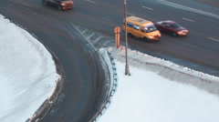 Movement of cars on road turn in winter on highway Stock Footage