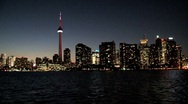 Stock Video Footage of Skyline, CN Tower at night, Toronto, Canada