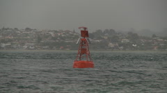 Navigation buoy sways in sea swell Stock Footage