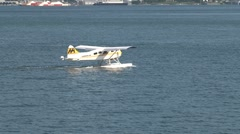 Float plane taking off  in harbor Vancouver, british columbia, Canada Stock Footage