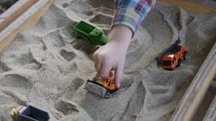 Sandbox , toy trucks Stock Footage