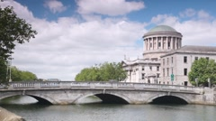 Four Courts and bridge across River Liffey in Dublin Stock Footage