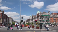 People and vehicle traffic on very wide O'Connell Street in Dublin - stock footage