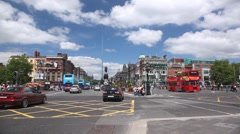 View from O'Connell Bridge on street with heavy vehicle traffic Stock Footage