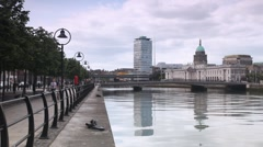 Calm Liffey River and magnificent Custom House in centre of Dublin Stock Footage