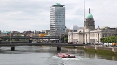 Tourist boat goes on Liffey River near Custom House Stock Footage